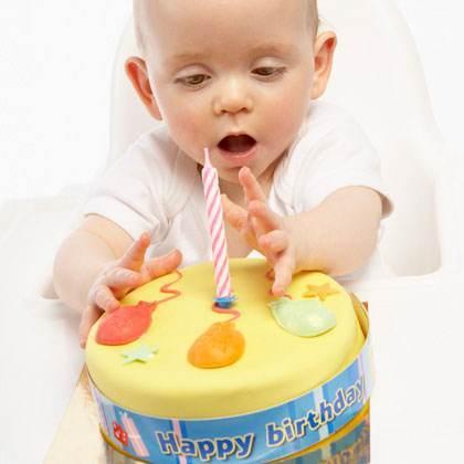 baby-touching-birthday-cake-photo-420x420-ts-79167193